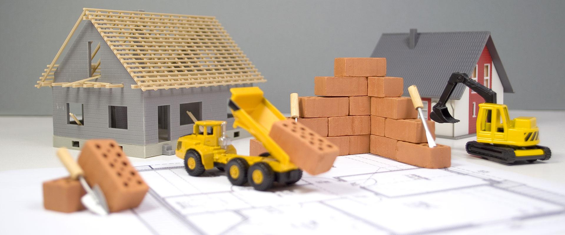 Abbildung Modellhaus und Minibagger