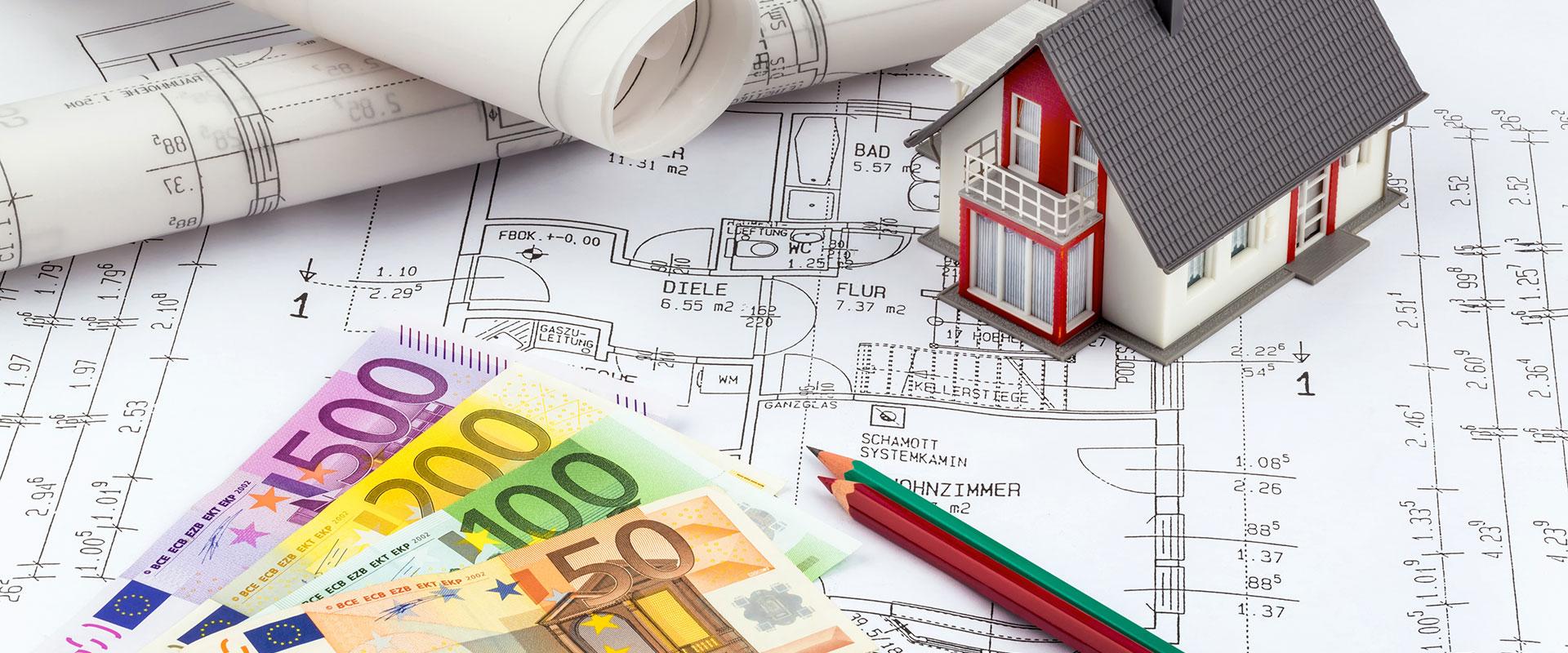 Abbildung Modellhaus und Geldnoten