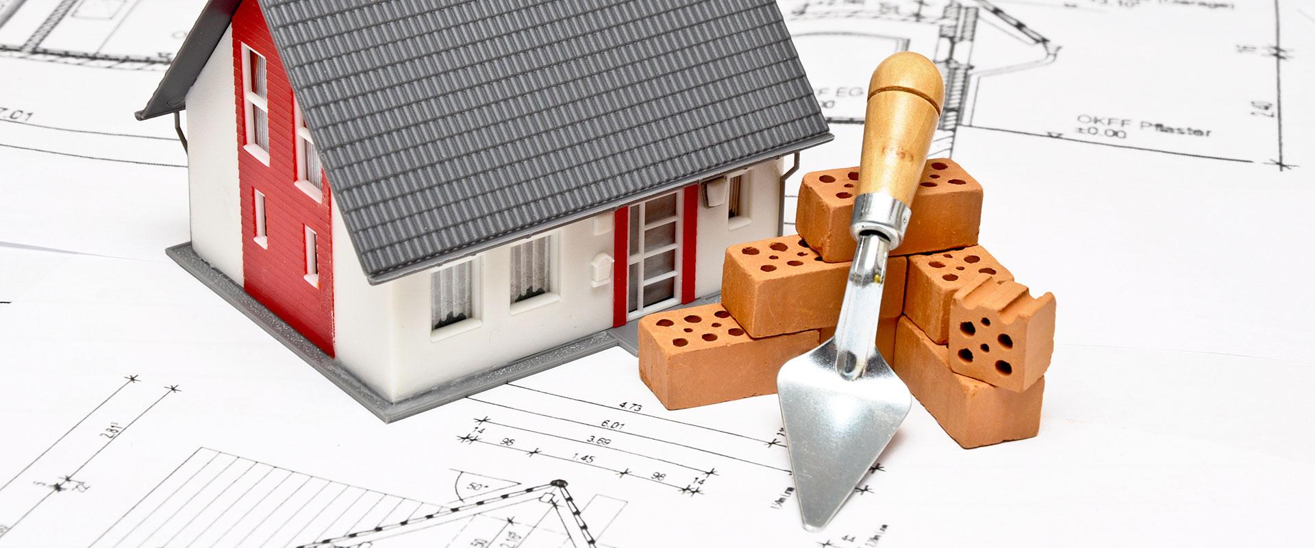 Abbildung Modellhaus und Bausteine
