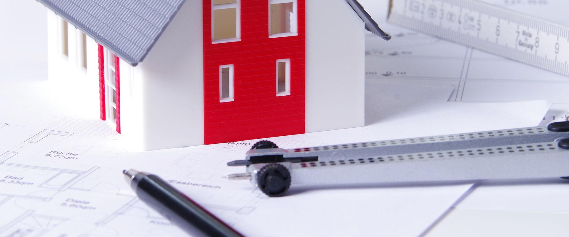 Abbildung Modellhaus und Zirkel