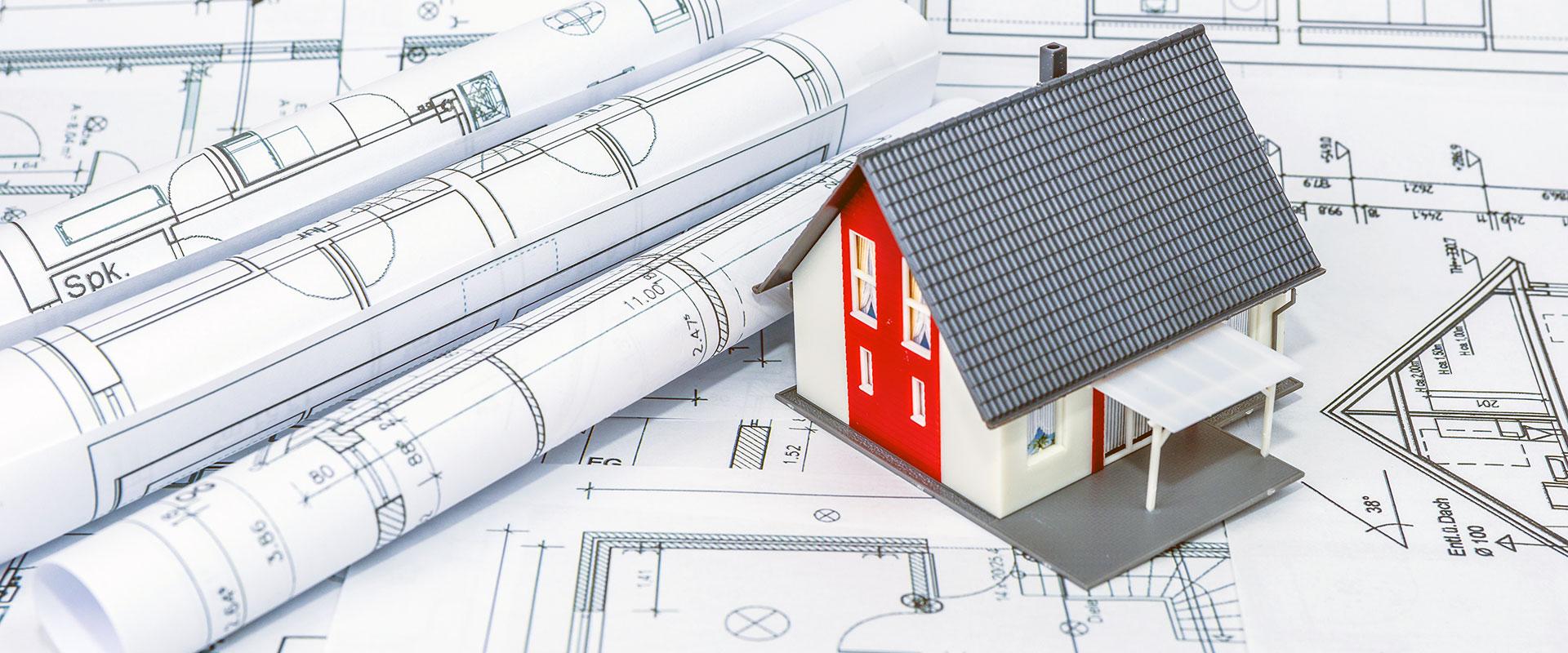 Abbildung Modellhaus auf Grundrissen